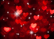 Red hearts shape with sparkles as background Stock Photo