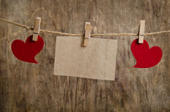 Red hearts with sheet of paper hanging on the clothesline Royalty Free Stock Photo