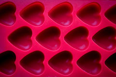 Red hearts. Silicone mold background Stock Image