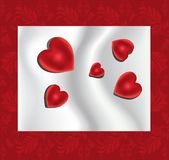 Red hearts on the silk background Royalty Free Stock Photography