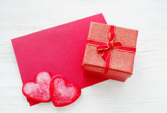 Red hearts, small gift box with a bow and a red empty card for an inscription Royalty Free Stock Image