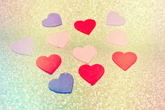Red hearts. On the sparkling background royalty free stock photography