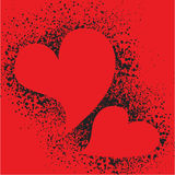 Red hearts on spray grunge splatter background Royalty Free Stock Images