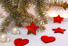 Red hearts, stars and silver balls. And candles royalty free stock photography