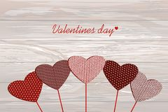 Red hearts on a stick with the image. Valentine`s Day. Vector il. Lustration. Greeting card with empty space for the label or advertising. On a wooden background Royalty Free Stock Photo