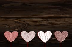 Red hearts on a stick with the image. Valentine`s Day. Vector il. Lustration. Greeting card with empty space for the label or advertising. On a wooden background Stock Photography