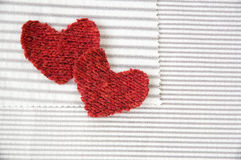 Red hearts on striped fabric Royalty Free Stock Image