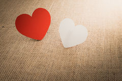 Red hearts symbol on fabric sack surface Royalty Free Stock Image