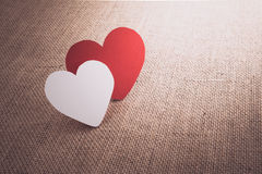 Red hearts symbol on fabric sack surface Royalty Free Stock Photos