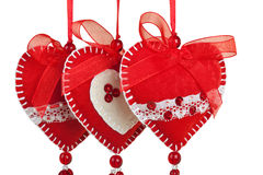 Red hearts of the textiles with beads and bow Stock Photos