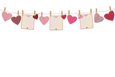 Red hearts and three blanks paper with a picture hanging Royalty Free Stock Photography