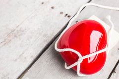 Red Hearts tied with white rope. On wooden Royalty Free Stock Image