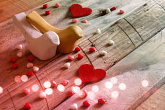 Red hearts and two loving birds on wooden table Stock Images