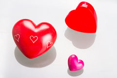 Red hearts for Valentines. With glass reflection Royalty Free Stock Photo