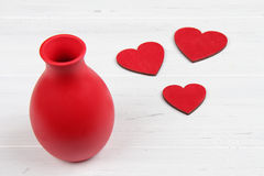 Red hearts and vase on white background Royalty Free Stock Image