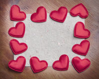 Red hearts on vintage  paper background Stock Photos