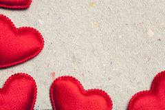 Red hearts on vintage  paper background Stock Photo
