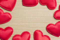 Red hearts on vintage  paper background Royalty Free Stock Photography