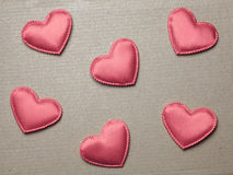 Red hearts on vintage  paper background Stock Images