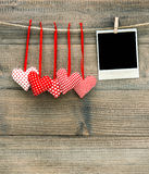 Red hearts and vintage photo frame. Valentines Day decoration Royalty Free Stock Photography