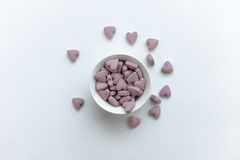 Red hearts vitamins in a cup Royalty Free Stock Photography