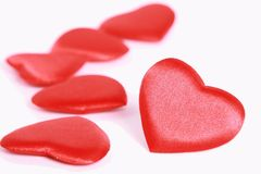 Red hearts on white. Red shiny hearts on white Stock Photo