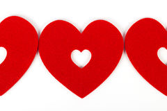Red hearts in white backgrond. Red hearts standing in white backgrond Stock Photo