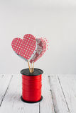 Red hearts on a white background. Red heart handmade on a white background Stock Photos