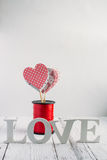 Red hearts on a white background. Red heart handmade on a white background Stock Images