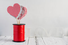 Red hearts on a white background. Red heart handmade on a white background Stock Photo