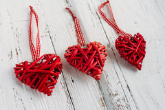 Red hearts on a white background. Red hearts made of wicker handmade on white background Royalty Free Stock Images