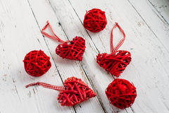 Red hearts on a white background. Red hearts made of wicker handmade on white background Royalty Free Stock Photos