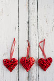 Red hearts on a white background. Red hearts made of wicker handmade on white background Stock Photo