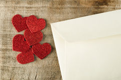Red hearts and white envelope Royalty Free Stock Photos
