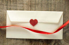 Red hearts and white envelope Royalty Free Stock Photo