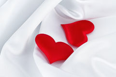 Red Hearts on White Silk Stock Photography