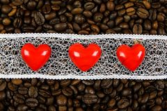 Red hearts on white strip on the coffee beans background Stock Photo