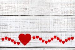 Red hearts on white wood Royalty Free Stock Image