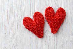 Red hearts on white wooden background Royalty Free Stock Images
