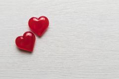 Red hearts on a white wooden substrate. Background of red hearts on a white wooden substrate Royalty Free Stock Photography