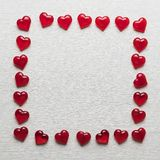 Red hearts on a white wooden substrate. Background of red hearts on a white wooden substrate Royalty Free Stock Images
