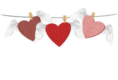 Red hearts with wings hanging on a rope. clothes pegs Stock Photos