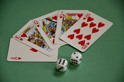 Red Hearts Winners Poker Royal Flush and Dice on Green Baize Tab Royalty Free Stock Photo