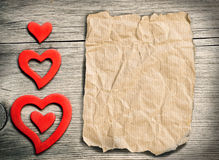 Red hearts on wood - retro background Stock Image