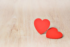 Red hearts on wood Stock Images