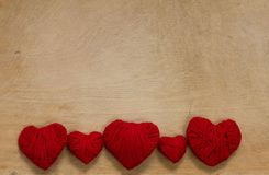 Red hearts on a wooden background Stock Photo