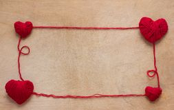 Red hearts on a wooden background Stock Image