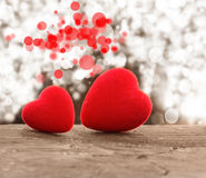 Red hearts. On a wooden background royalty free stock photography