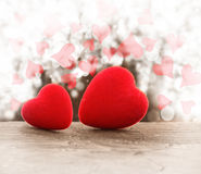 Red hearts. On a wooden background stock photo