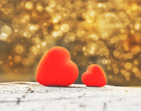 Red hearts. On a wooden background stock image